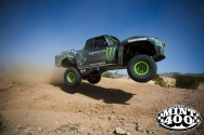 A truck soars into the air at the 2015 Polaris RZR Mint 400. Photo courtesy of the Mint 400.